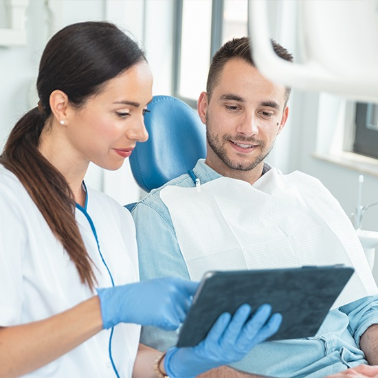 Woman going over paperwork with male patient