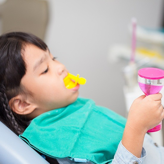 Young girl getting fluoride treatment