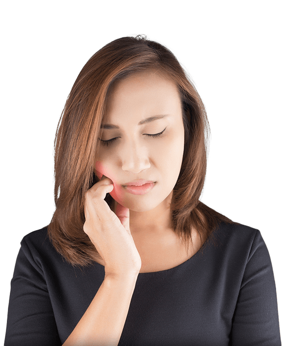 Woman in pain holding side of cheek before root canal therapy