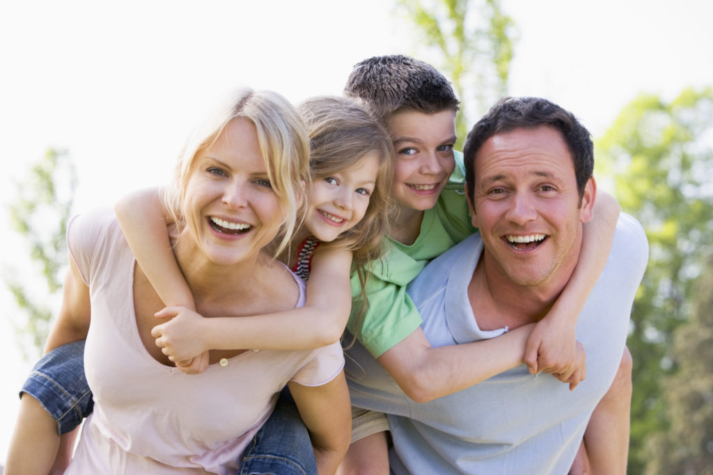 smiling parents and kids