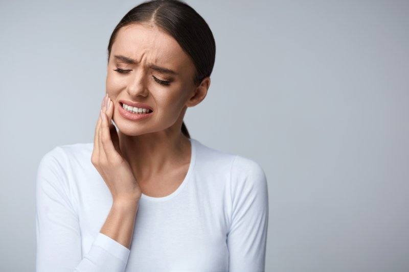 Woman with tooth pain.