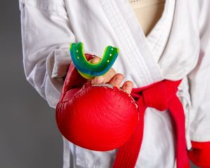 martial artist holding a mouthguard in their hand